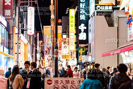 Minami Namba famous street with crowd of people walking shopping with dark night