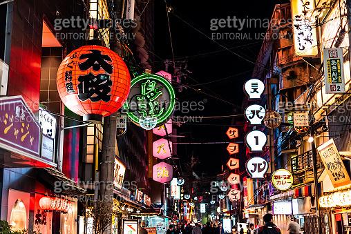 Minami Namba famous street with people walking in dark night and illuminated paper lanterns