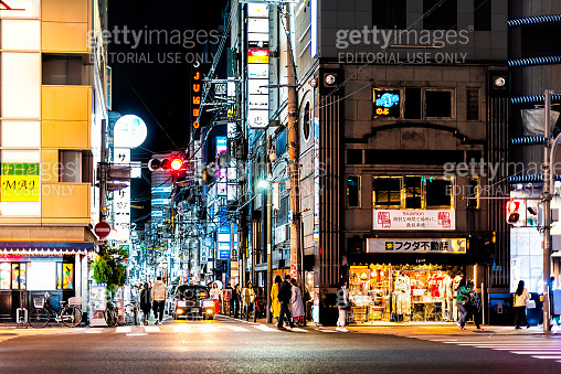 Minami Namba famous street with people walking shopping with traffic signal sign in night