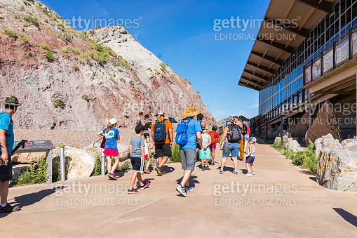 Exterior Quarry visitor center exhibit hall in Dinosaur National Monument Park with people