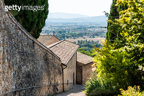 Assisi, Italy town or village city in Umbria with San Damiano church path during sunny summer day and road with nobody