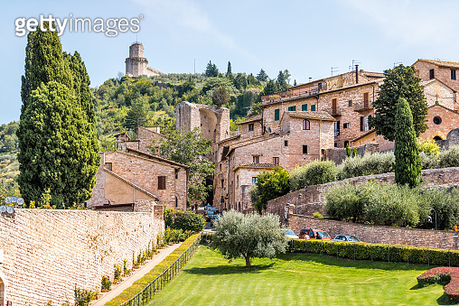 Assisi, Italy Giardini di San Francesco or Gardens of Saint Francis near Basilica with green grass lawn and ancient old medieval buildings in summer