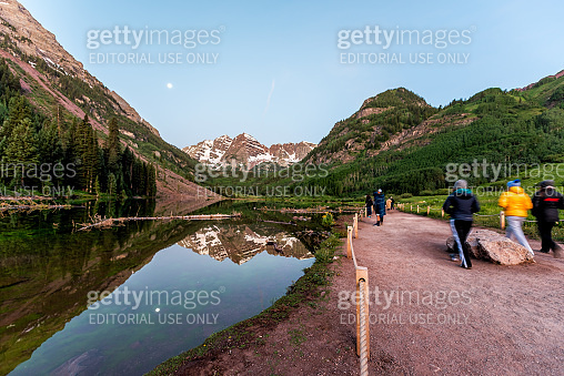 Maroon Bells lake wide angle view in Aspen, Colorado at blue hour with peak and snow