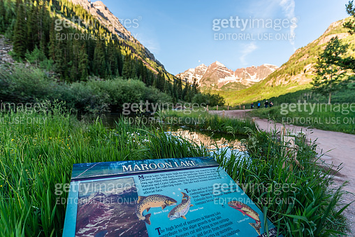 Maroon Bells view in Colorado with peak and snow in July 2019 summer and trail path road