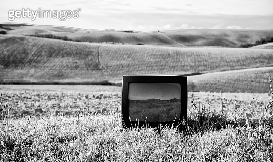 Old Television abandoned in a Field.