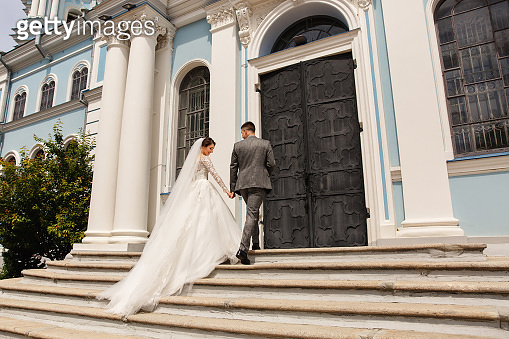 Bride and groom go to church on wedding day
