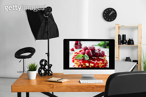 Computer on workplace of photographer in modern studio