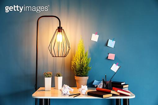 Modern workplace with lemon cypress tree in pot