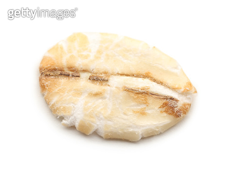 Raw oatmeal on white background