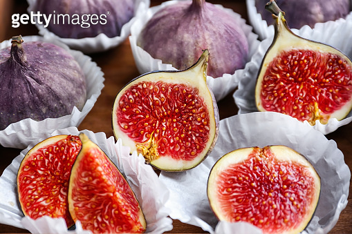 Fresh ripe figs on wooden table