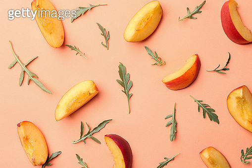 Composition with fresh sliced peaches on color background, top view