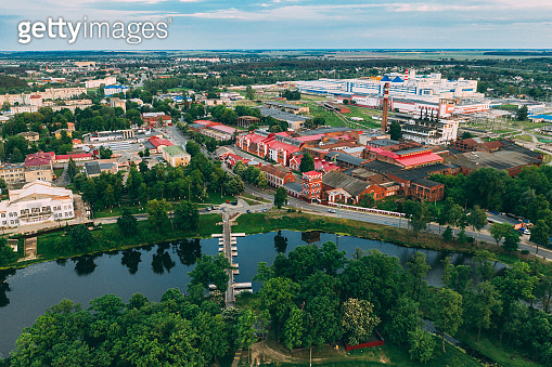 Dobrush, Gomel Region, Belarus. Aerial View Of Old Paper Factory Tower In Spring Day. Historical Heritage In Bird's-eye View