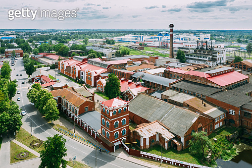 Dobrush, Gomel Region, Belarus. Aerial View Of Old Paper Factory Tower In Spring Sunny Day. Historical Heritage In Bird's-eye View