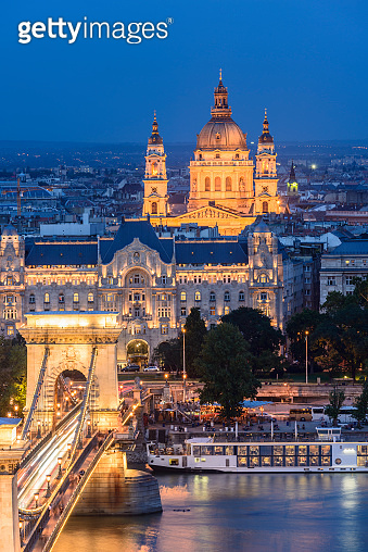 Chain Bridge over the Danube River and City Skyline at Sunset in Budapest Hungary