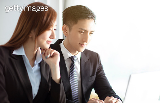 Business man and woman working together at meeting room