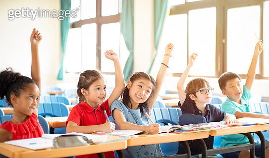 happy elementary school kids  in classroom