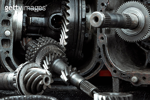 Dismantled car gearbox with gears, close-up. Repair box predach, repair of used cars. Metal background.