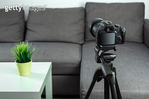 Online profession, blogger profession, SLR camera for shooting Vlog, close-up. Blogger, blogging, technology, online money, online courses. copy space.