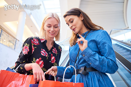 Woman showing what she bought