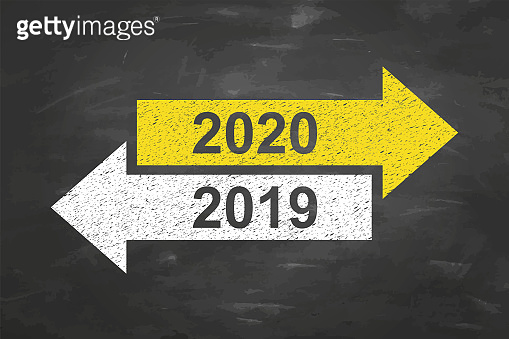 Old Year or New Year 2020 on Chalkboard Background