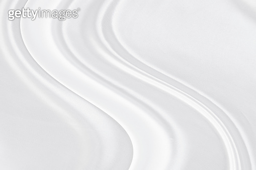 White grey fabric texture that is white silk clean background with beautiful soft blur pattern luxury.