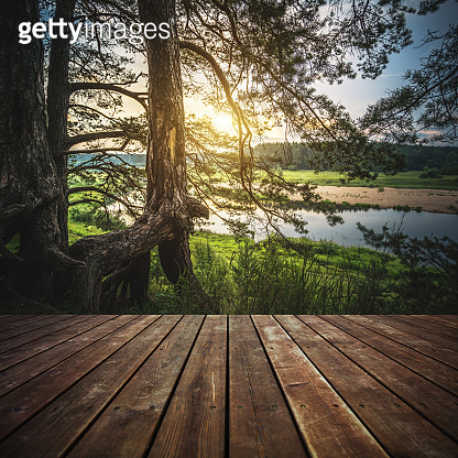 Wooden floor and beautiful landscape at sunset.