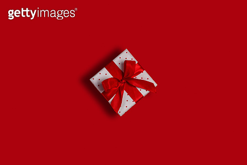 Polka dot gift box on red background