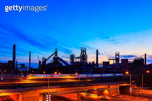 Abandoned factory steel structure night scene, panorama, sunset glow