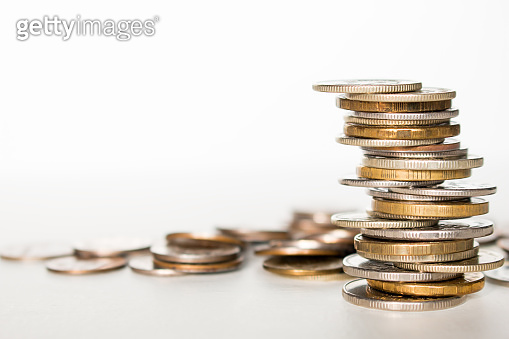 stack of coins on white background with place for text concept saving finance business income growth