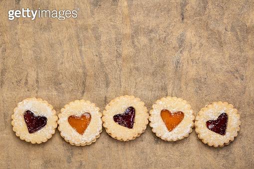 jam heart biscuits on textured paper