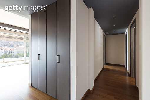 Corridor with large closets and window