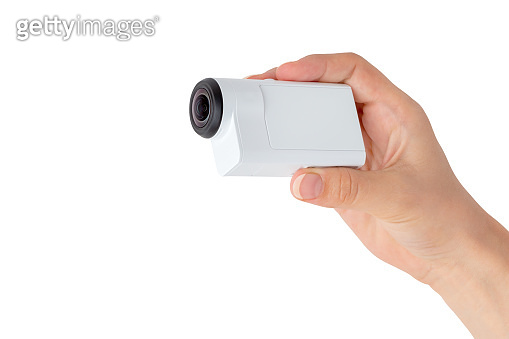Portable video camera on a white background. Action camera close up.