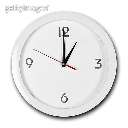 Large round white wall clock with white frame. The hands point to 1 o'clock. Close up. Isolated on white background