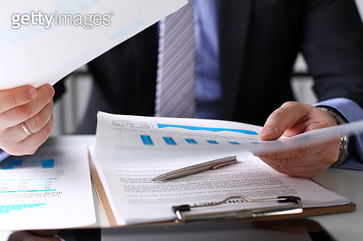 Male clerk arm examine important financial papers