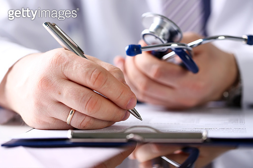 Male doctor arm hold silver pen and pad