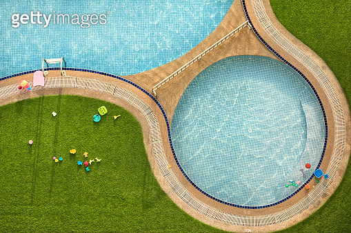close up outdoor child swimming pool and toys