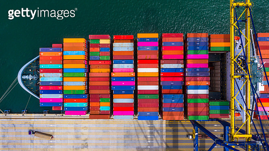 Aerial top view of container ship business logistic import and  export freight  transportation by container ship in open sea.