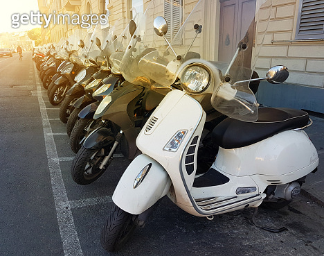 Row of motor scooters in Florence street. Italy