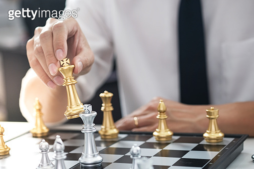 Businessman play with chess game. success management concept of business strategy and tactic challenge.