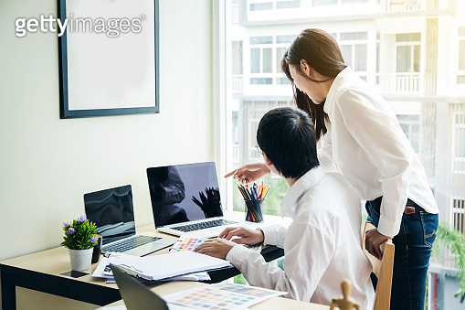 Architect or designer who plan work together in the office.