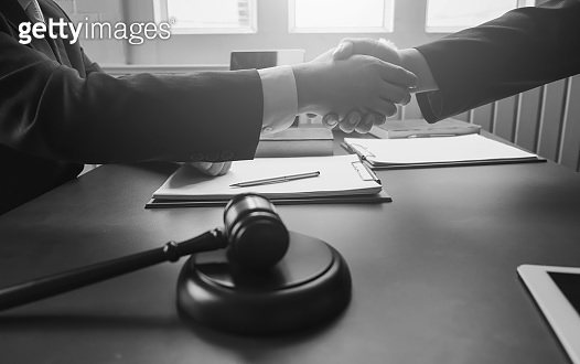 Business people shaking hands. Lawyer provide legal advice. Attorney at law, consultant. Black and white image.