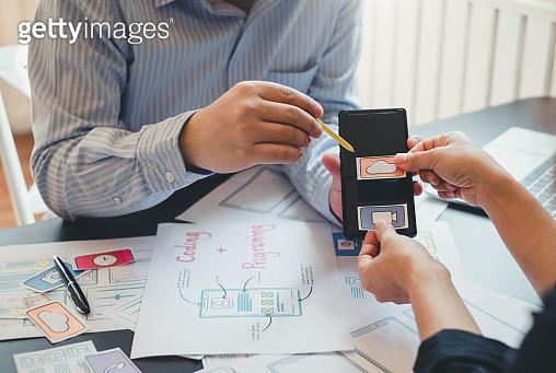 Professional designer website application app development ui ux on mobile phone.