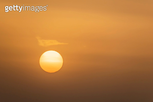 sunrise and the sun behind the clouds