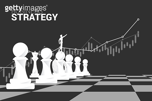 Silhouette of businessman point forward with chess piece and growth graph background.