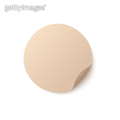 Round blank light brown paper sticker with folded edge.