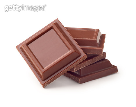 pieces of black chocolate on a white background