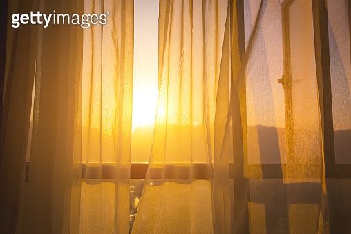 Curtain at the window of room in the morning