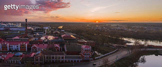 Old paper mill in Belarus in the fall at sunset. View from above