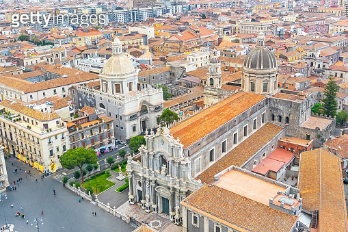 Piazza Duomo or Cathedral Square with Cathedral of Santa Agatha, aerial top view city Catania Italy.