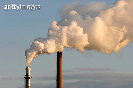smoke and steam from a factory chimney